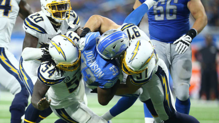 DETROIT, MI - SEPTEMBER 15: Kerryon Johnson #33 of the Detroit Lions runs the ball and is tackled by Joey Bosa #97 and Melvin Ingram #54 of the Los Angeles Chargers in the third quarter at Ford Field on September 15, 2019 in Detroit, Michigan. (Photo by Rey Del Rio/Getty Images)
