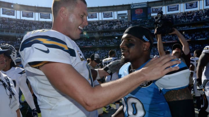 SAN DIEGO, CA - SEPTEMBER 13: Quarterback Philip Rivers #17 of the San Diego Chargers shakes hands with cornerback Quandre Diggs #28 of the Detroit Lions after the Chargers defeated the Lions 33-28 at Qualcomm Stadium on September 13, 2015 in San Diego, California. (Photo by Donald Miralle/Getty Images)