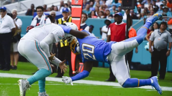 MIAMI, FL - SEPTEMBER 29: Desmond King #20 of the Los Angeles Chargers tackles Josh Rosen #3 of the Miami Dolphins during the third quarter of the game at Hard Rock Stadium on September 29, 2019 in Miami, Florida. (Photo by Eric Espada/Getty Images)