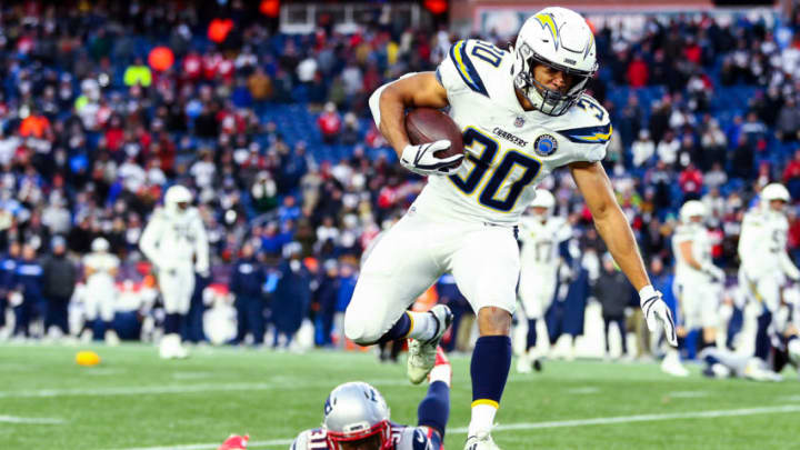 FOXBOROUGH, MASSACHUSETTS - JANUARY 13: Austin Ekeler #30 of the Los Angeles Chargers runs with the ball during the AFC Divisional Playoff Game against the New England Patriots at Gillette Stadium on January 13, 2019 in Foxborough, Massachusetts. (Photo by Adam Glanzman/Getty Images)