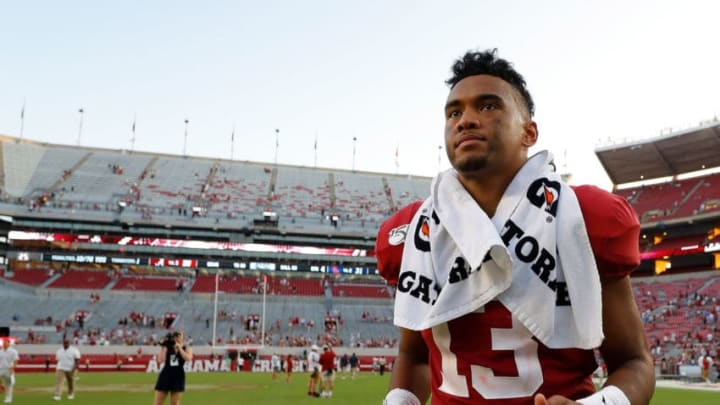 TUSCALOOSA, ALABAMA - SEPTEMBER 28: Tua Tagovailoa #13 of the Alabama Crimson Tide runs off the field after their 59-31 win over the Mississippi Rebels at Bryant-Denny Stadium on September 28, 2019 in Tuscaloosa, Alabama. (Photo by Kevin C. Cox/Getty Images)