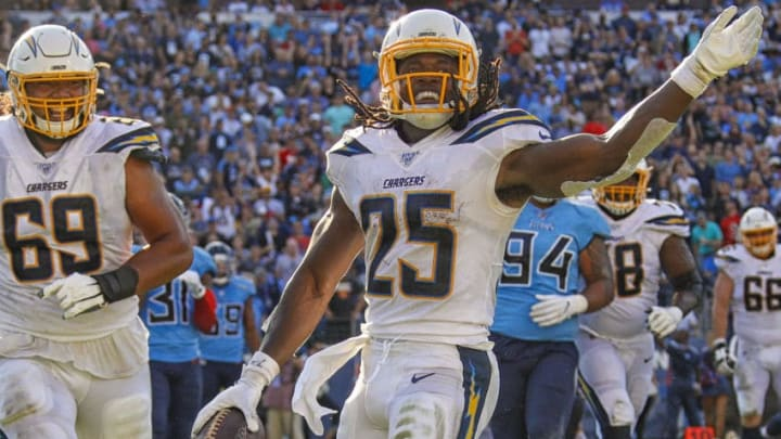 NASHVILLE, TENNESSEE - OCTOBER 20: Melvin Gordon #25 of the Los Angeles Chargers reacts after scoring a touchdown against the Tennessee Titans at Nissan Stadium on October 20, 2019 in Nashville, Tennessee. (Photo by Frederick Breedon/Getty Images)