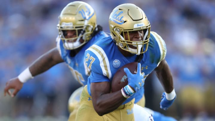 LOS ANGELES, CALIFORNIA - OCTOBER 26: Joshua Kelley #27 of the UCLA Bruins runs with the ball for short yardage during the first half of a game against the Arizona State Sun Devils on October 26, 2019 in Los Angeles, California. (Photo by Sean M. Haffey/Getty Images)