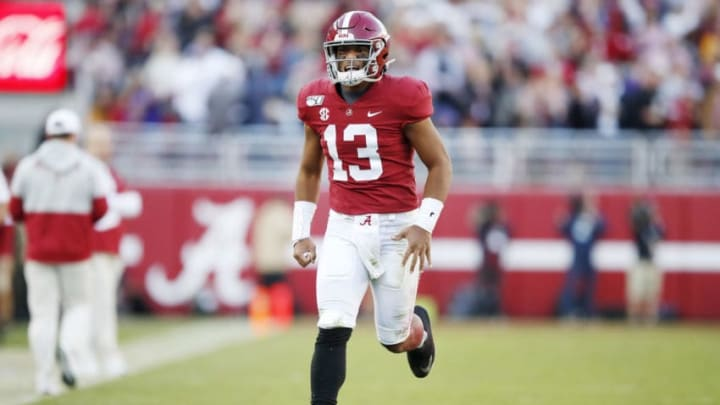 TUSCALOOSA, ALABAMA - NOVEMBER 09: Tua Tagovailoa #13 of the Alabama Crimson Tide celebrates throwing a touchdown pass during the second quarter against the LSU Tigers in the game at Bryant-Denny Stadium on November 09, 2019 in Tuscaloosa, Alabama. (Photo by Todd Kirkland/Getty Images)