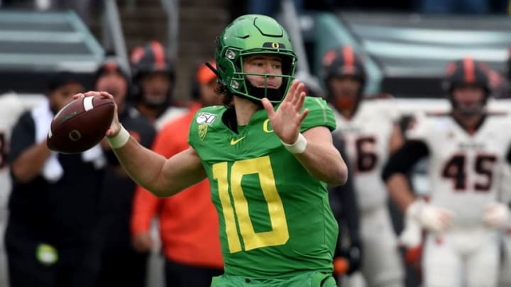 EUGENE, OREGON - NOVEMBER 30: Quarterback Justin Herbert #10 of the Oregon Ducks passes the ball during the first half of the game against the Oregon State Beavers at Autzen Stadium on November 30, 2019 in Eugene, Oregon. (Photo by Steve Dykes/Getty Images)