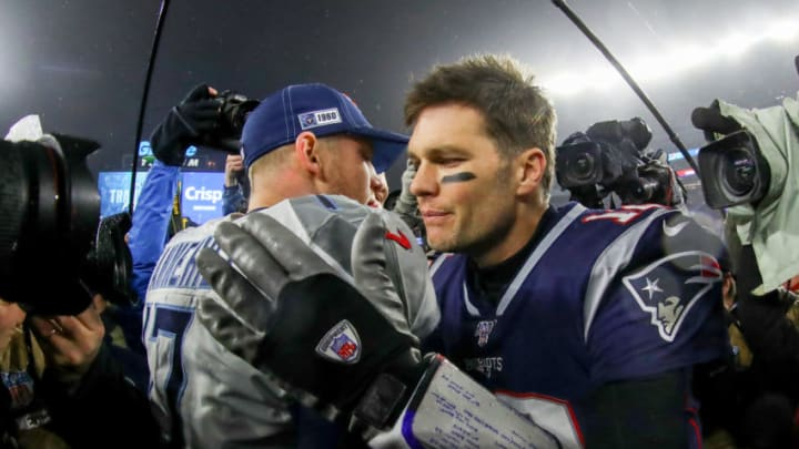 FOXBOROUGH, MASSACHUSETTS - JANUARY 04: Ryan Tannehill #17 of the Tennessee Titans is congratulated by Tom Brady #12 of the New England Patriots after their 20-13 win in the AFC Wild Card Playoff game at Gillette Stadium on January 04, 2020 in Foxborough, Massachusetts. (Photo by Maddie Meyer/Getty Images)