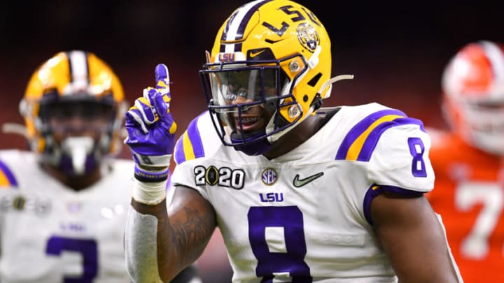 NEW ORLEANS, LA - JANUARY 13: Patrick Queen #8 of the LSU Tigers celebrates a defensive stop against the Clemson Tigers during the College Football Playoff National Championship held at the Mercedes-Benz Superdome on January 13, 2020 in New Orleans, Louisiana. (Photo by Jamie Schwaberow/Getty Images)