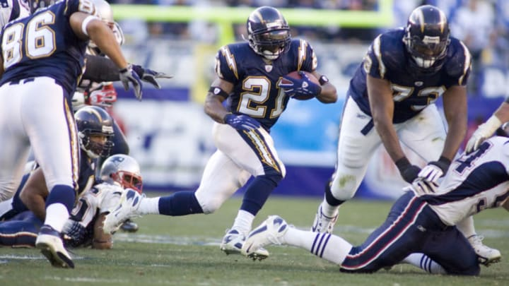 LaDainian Tomlinson running back for the San Diego Chargers rushes loking for a hole in a game against the New England Patriots at Qualcomm Stadium in San Diego, California on January 14, 2007. (Photo by Peter Brouillet/Getty Images)