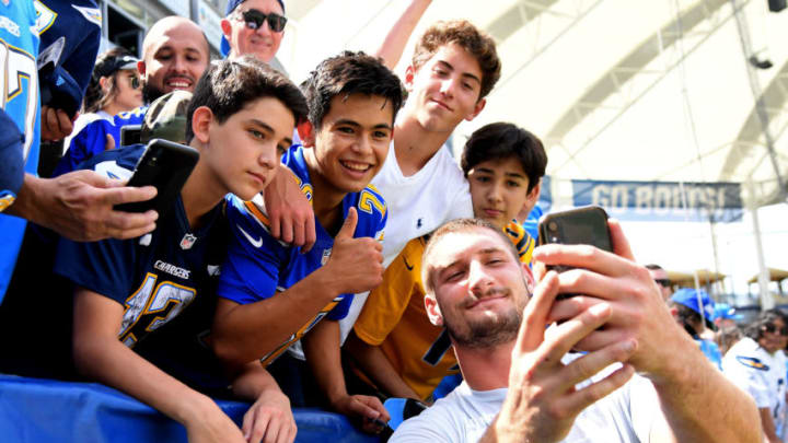 CARSON, CA - SEPTEMBER 22: Defensive end Joey Bosa #97 of the Los Angeles Chargers poses for a selfie with fans before the game against the Houston Texans at Dignity Health Sports Park on September 22, 2019 in Carson, California. (Photo by Jayne Kamin-Oncea/Getty Images)