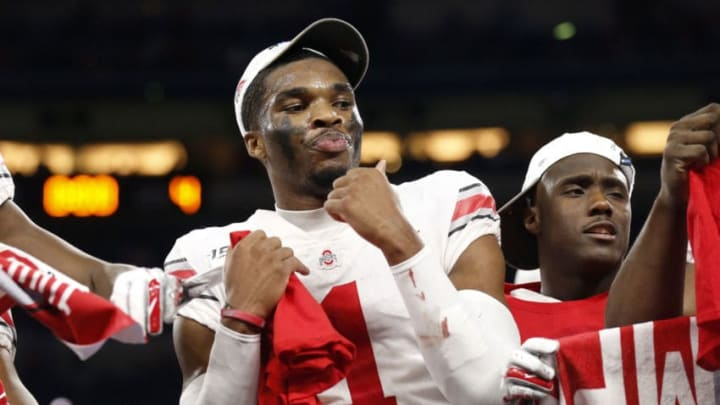 INDIANAPOLIS, INDIANA - DECEMBER 07: Jeff Okudah #01 of the Ohio State Buckeyes on the post game stage after winning the Big Ten Championship game over the Wisconsin Badgers at Lucas Oil Stadium on December 07, 2019 in Indianapolis, Indiana. (Photo by Justin Casterline/Getty Images)