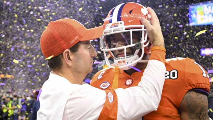 NEW ORLEANS, LA - JANUARY 13: Head coach Dabo Swinney of the Clemson Tigers embraces Isaiah Simmons #11 during the College Football Playoff National Championship held at the Mercedes-Benz Superdome on January 13, 2020 in New Orleans, Louisiana. (Photo by Justin Tafoya/Getty Images)