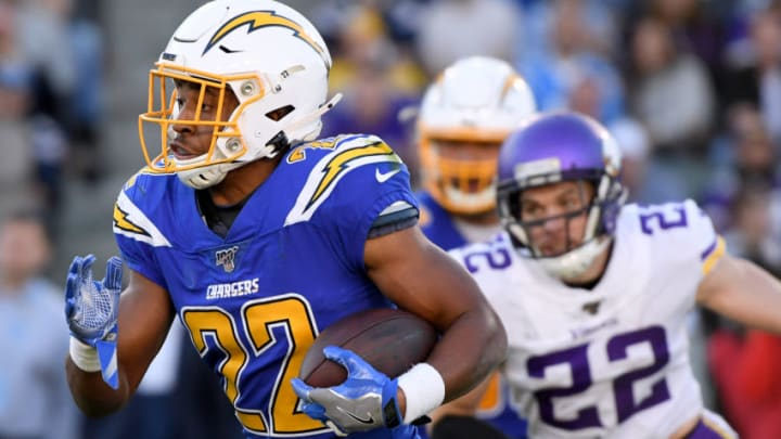 CARSON, CALIFORNIA - DECEMBER 15: Justin Jackson #22 of the Los Angeles Chargers runs with the ball ahead of Harrison Smith #22 of the Minnesota Vikings during a 39-10 Vikings win at Dignity Health Sports Park on December 15, 2019 in Carson, California. (Photo by Harry How/Getty Images)