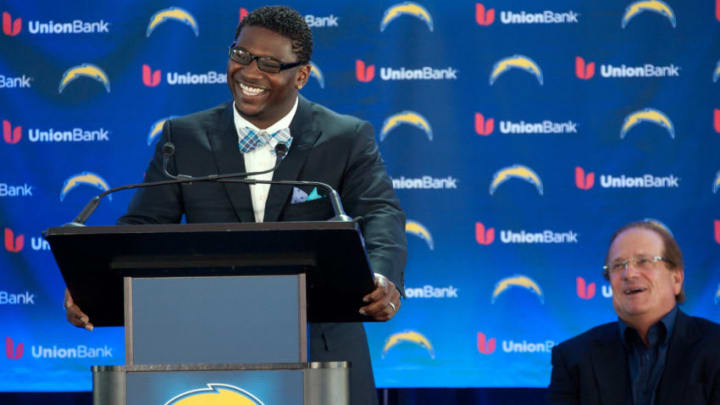 SAN DIEGO, CA - JUNE 18: LaDainian Tomlinson speaks as San Diego Chargers owner Dean Spanos during his announcement of his retirement from professional football, after signing a one-day contract with the San Diego Chargers and being immediately released by the club, at Qualcomm Stadium on June 18, 2012 in San Diego, California. (Photo by Kent C. Horner/Getty Images)