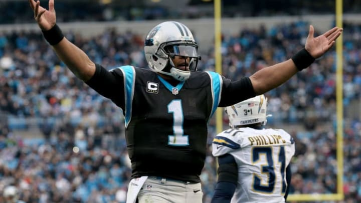 CHARLOTTE, NC - DECEMBER 11: Cam Newton #1 of the Carolina Panthers salutes the crowd after a 2nd quarter touchdown pass against the San Diego Chargers during their game at Bank of America Stadium on December 11, 2016 in Charlotte, North Carolina. (Photo by Streeter Lecka/Getty Images)