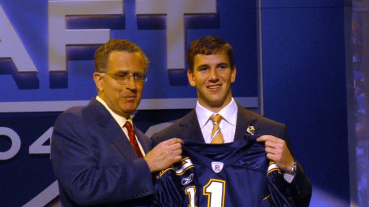 2004 NFL Draft first overall pick Eli Manning (right) with NFL Commisioner Paul Tagliabue, at Madison Square Garden in New York, April 24. Manning, shown with San Diego Chargers jersey, was traded to the New York Giants later in the day. (Photo by Allan Grdovic/Getty Images)