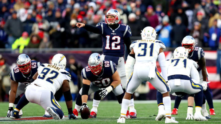FOXBOROUGH, MASSACHUSETTS - JANUARY 13: Tom Brady #12 of the New England Patriots reacts at the line of scrimmage during the fourth quarter in the AFC Divisional Playoff Game against the Los Angeles Chargers at Gillette Stadium on January 13, 2019 in Foxborough, Massachusetts. (Photo by Maddie Meyer/Getty Images)