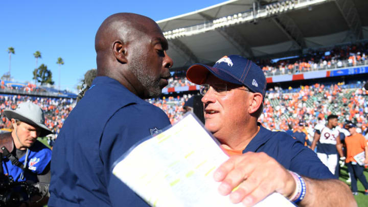 CARSON, CALIFORNIA - OCTOBER 06: Head coach Vic Fangio of the Denver Broncos and head coach Anthony Lynn of the Los Angeles Chargers meet after a 20-13 Broncos win at Dignity Health Sports Park on October 06, 2019 in Carson, California. (Photo by Harry How/Getty Images)
