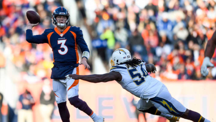 DENVER, CO - DECEMBER 1: Drew Lock #3 of the Denver Broncos passes under pressure by Melvin Ingram III #54 of the Los Angeles Chargers in the first quarter of a game at Empower Field at Mile High on December 1, 2019 in Denver, Colorado. (Photo by Dustin Bradford/Getty Images)