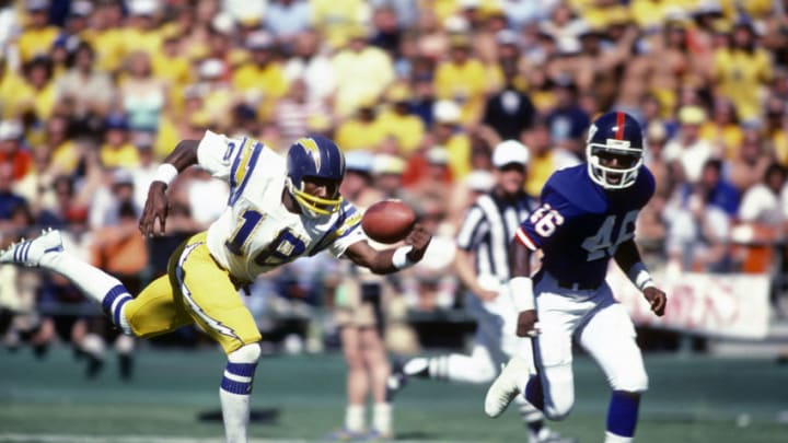 SAN DIEGO, CA - OCTOBER 19: Charlie Joiner #18 of the San Diego Chargers reaches out for this pass against the New York Giants during an NFL football game October 19, 1980 at Jack Murphy Stadium in San Diego, California. Joiner played for the Chargers from 1976-86. (Photo by Focus on Sport/Getty Images)