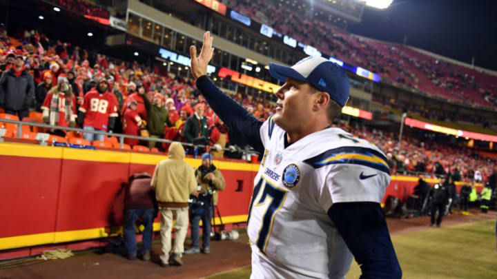 KANSAS CITY, MISSOURI - DECEMBER 13: Quarterback Philip Rivers #17 of the Los Angeles Chargers waves to Kansas City Chiefs fans after the Chargers defeated the Chiefs with a final score of 29-28 to win the game at Arrowhead Stadium on December 13, 2018 in Kansas City, Missouri. (Photo by Peter Aiken/Getty Images)