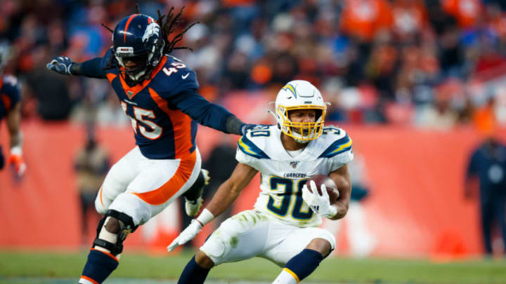 DENVER, CO - DECEMBER 1: running back Austin Ekeler #30 of the Los Angeles Chargers cuts to elude linebacker Alexander Johnson #45 of the Denver Broncos during the third quarter at Empower Field at Mile High on December 1, 2019 in Denver, Colorado. The Broncos defeated the Chargers 23-20. (Photo by Justin Edmonds/Getty Images)