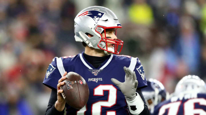 FOXBOROUGH, MASSACHUSETTS - JANUARY 04: Tom Brady #12 of the New England Patriots looks to pass during the AFC Wild Card Playoff game against the Tennessee Titans at Gillette Stadium on January 04, 2020 in Foxborough, Massachusetts. (Photo by Adam Glanzman/Getty Images)