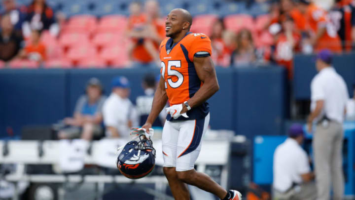 DENVER, CO - AUGUST 29: Cornerback Chris Harris #25 of the Denver Broncos runs on the field before a preseason game against the Arizona Cardinals at Broncos Stadium at Mile High on August 29, 2019 in Denver, Colorado. (Photo by Justin Edmonds/Getty Images)