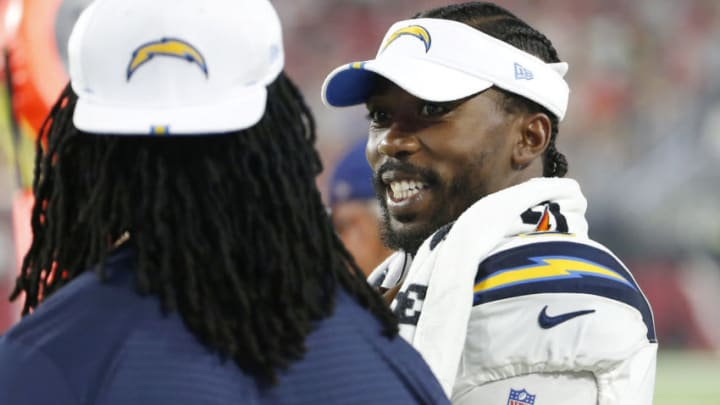 GLENDALE, ARIZONA - AUGUST 08: Quarterback Tyrod Taylor #5 of the Los Angeles Chargers (R) talks with a teammate on the sideline during the first half of the NFL pre-season game against the Arizona Cardinals at State Farm Stadium on August 08, 2019 in Glendale, Arizona. (Photo by Ralph Freso/Getty Images)