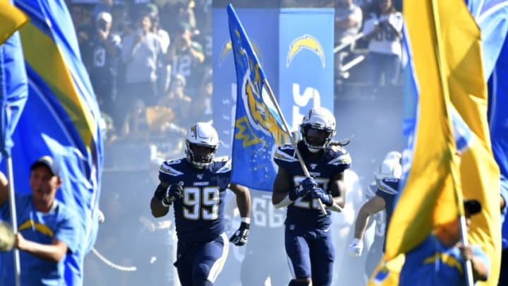 CARSON, CA - NOVEMBER 03: Jerry Tillery #99 of the Los Angeles Chargers and Rayshawn Jenkins #23 run onto the field before playing the Green Bay Packers at Dignity Health Sports Park on November 3, 2019 in Carson, California. Chargers won 26-11. (Photo by John McCoy/Getty Images)