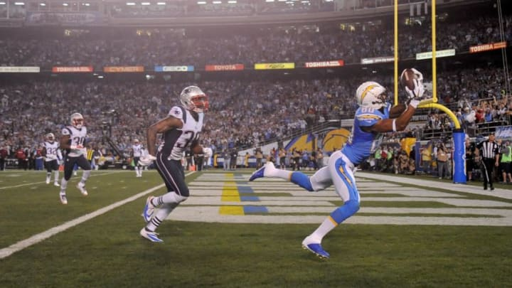 SAN DIEGO, CA- DECEMBER 7: Malcom Floyd #80 of the San Diego Chargers catches a touchdown pass against Brandon Browner #39 of the New England Patriots during an NFL game at Qualcomm Stadium on December 7, 2014 in San Diego, California. (Photo by Donald Miralle/Getty Images)