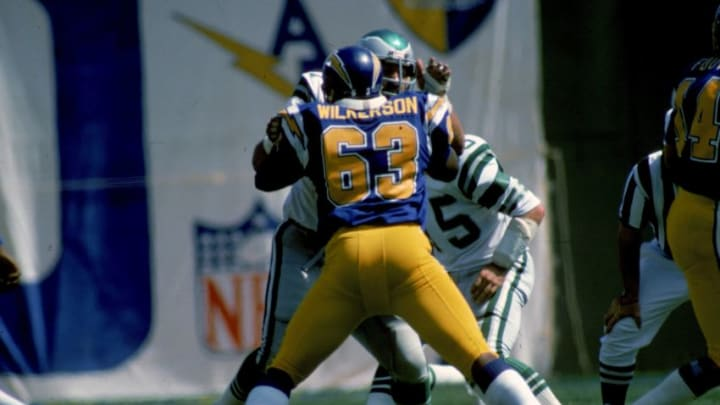SAN DIEGO, CA - OCTOBER 6: Guard Doug Wilkerson #63 of the San Diego Chargers takes on defensive tackle Jerry Patton #77 of the Philadelphia Eagles at San Diego Stadium on October 6, 1974 in San Diego, California. The Eagles defeated the Chargers 13-7. (Photo by James Flores/Getty Images)