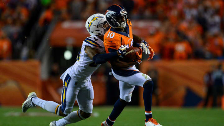 DENVER, CO - SEPTEMBER 11: Wide receiver Emmanuel Sanders #10 of the Denver Broncos is tackled by cornerback Trevor Williams #24 of the Los Angeles Chargers in the third quarter of the game at Sports Authority Field at Mile High on September 11, 2017 in Denver, Colorado. (Photo by Dustin Bradford/Getty Images)