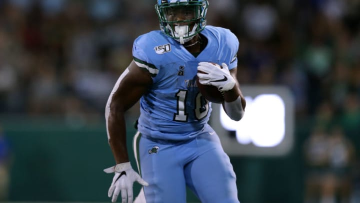NEW ORLEANS, LOUISIANA - SEPTEMBER 19: Darius Bradwell #10 of the Tulane Green Wave runs with the ball during a game against the Houston Cougars at Yulman Stadium on September 19, 2019 in New Orleans, Louisiana. (Photo by Jonathan Bachman/Getty Images)