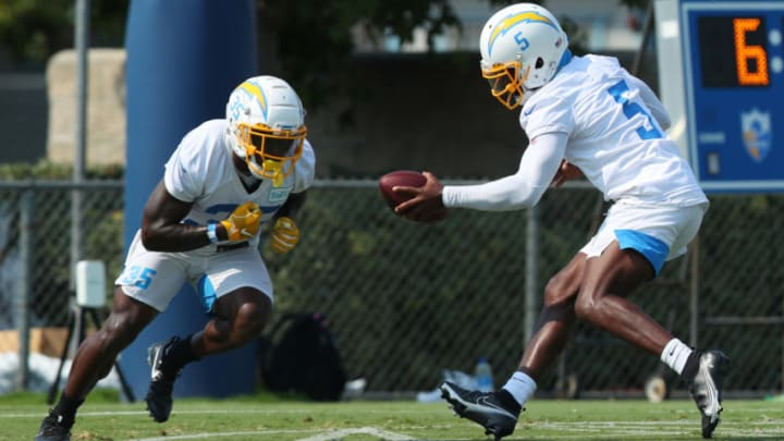 COSTA MESA, CALIFORNIA - AUGUST 19: Tyrod Taylor #5 of the Los Angeles Chargers hands the ball off to running back Derrick Gore #35 during Los Angeles Chargers Training Camp on August 19, 2020 in Costa Mesa, California. (Photo by Joe Scarnici/Getty Images)