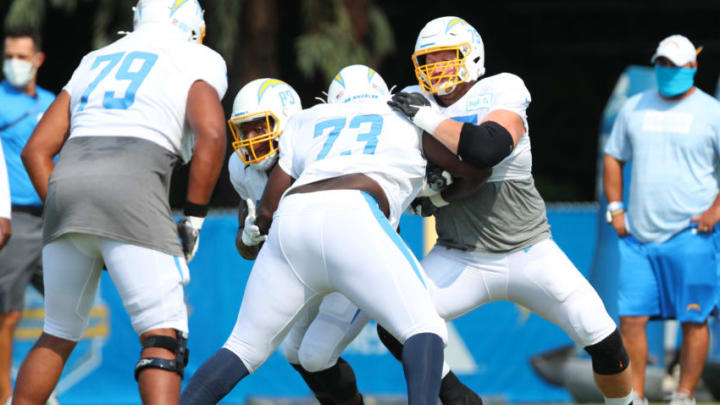 COSTA MESA, CALIFORNIA - AUGUST 20: Bryan Bulaga #75 of the Los Angeles Chargers and Tyree St. Louis #73 square off during the Los Angeles Chargers Training Camp at the Jack Hammett Sport Complex on August 20, 2020 in Costa Mesa, California. (Photo by Joe Scarnici/Getty Images)
