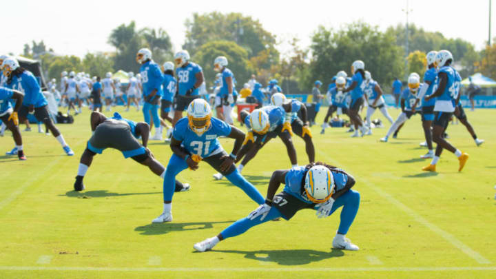COSTA MESA, CALIFORNIA - AUGUST 25: Tevaughn Campbell #37 of the Los Angeles Chargers and Kevin McGill #31 warm up with the team during Los Angeles Chargers Training Camp at the Jack Hammett Sports Complex on August 25, 2020 in Costa Mesa, California. (Photo by Joe Scarnici/Getty Images)