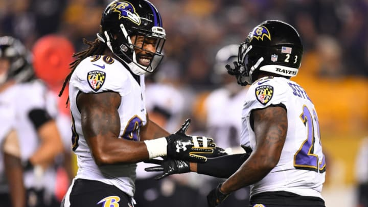 PITTSBURGH, PA - SEPTEMBER 30: Tony Jefferson #23 of the Baltimore Ravens is congratulated by Za'Darius Smith #90 after a fumble recovery in the first quarter during the game against the Pittsburgh Steelers at Heinz Field on September 30, 2018 in Pittsburgh, Pennsylvania. (Photo by Joe Sargent/Getty Images)