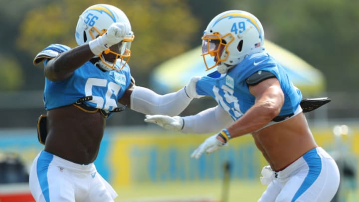 COSTA MESA, CALIFORNIA - AUGUST 21: Kenneth Murray #56 of the Los Angeles Chargers and Drue Tranquill #49 square off for a drill during Los Angeles Chargers Training Camp at the Jack Hammett Sports Complex on August 21, 2020 in Costa Mesa, California. (Photo by Joe Scarnici/Getty Images)