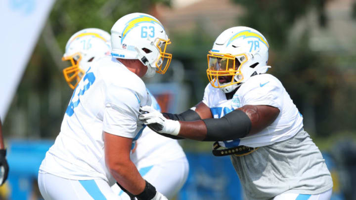 COSTA MESA, CALIFORNIA - AUGUST 24: Nathan Gilliam #63 of the Los Angeles Chargers and Trent Scott #78 run a play during Los Angeles Chargers Training Camp at the Jack Hammett Sports Complex on August 24, 2020 in Costa Mesa, California. (Photo by Joe Scarnici/Getty Images)