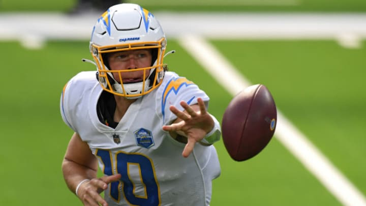 INGLEWOOD, CALIFORNIA - SEPTEMBER 20: Quarterback Justin Herbert #10 of the Los Angeles Chargers pitches back the ball against the Kansas City Chiefs during the second half at SoFi Stadium on September 20, 2020 in Inglewood, California. (Photo by Harry How/Getty Images)