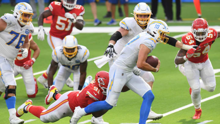 INGLEWOOD, CALIFORNIA - SEPTEMBER 20: Quarterback Justin Herbert #10 of the Los Angeles Chargers rushes the ball past nose tackle Derrick Nnadi #91 of the Kansas City Chiefs during the fourth quarter at SoFi Stadium on September 20, 2020 in Inglewood, California. (Photo by Harry How/Getty Images)