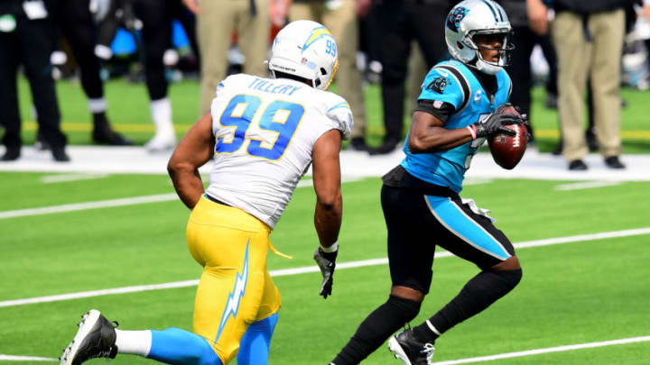 INGLEWOOD, CALIFORNIA - SEPTEMBER 27: Teddy Bridgewater #5 of the Carolina Panthers rolls out of the pocket away from Jerry Tillery #99 of the Los Angeles Chargers at SoFi Stadium on September 27, 2020 in Inglewood, California. (Photo by Harry How/Getty Images)