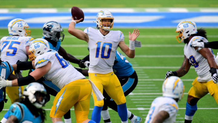 INGLEWOOD, CALIFORNIA - SEPTEMBER 27: Justin Herbert #10 of the Los Angeles Chargers passes in the pocket during a 21-16 loss to the Carolina Panthers at SoFi Stadium on September 27, 2020 in Inglewood, California. (Photo by Harry How/Getty Images)
