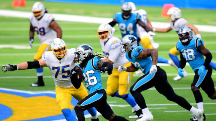 INGLEWOOD, CALIFORNIA - SEPTEMBER 27: Donte Jackson #26 of the Carolina Panthers runs back his interception past Bryan Bulaga #75 of the Los Angeles Chargers during the second quarter in a 21-16 Panthers win at SoFi Stadium on September 27, 2020 in Inglewood, California. (Photo by Harry How/Getty Images)