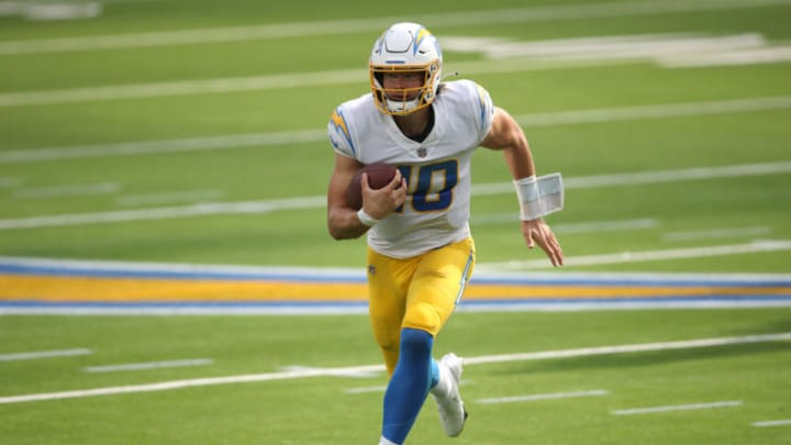 INGLEWOOD, CALIFORNIA - SEPTEMBER 27: Justin Herbert #10 of the Los Angeles Chargers is forced from the pocket and scrambles for extra yards during the second half of a game against the Carolina Panthers at SoFi Stadium on September 27, 2020 in Inglewood, California. (Photo by Sean M. Haffey/Getty Images)