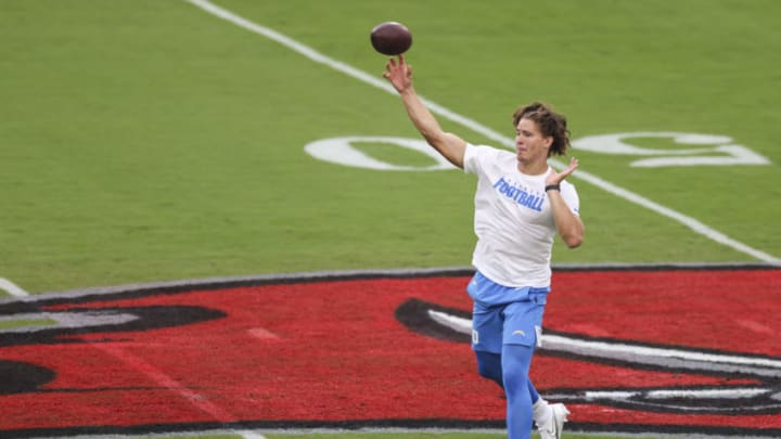 TAMPA, FLORIDA - OCTOBER 04: Justin Herbert #10 of the Los Angeles Chargers warms up before the start of a game against the Tampa Bay Buccaneers at Raymond James Stadium on October 04, 2020 in Tampa, Florida. (Photo by James Gilbert/Getty Images)