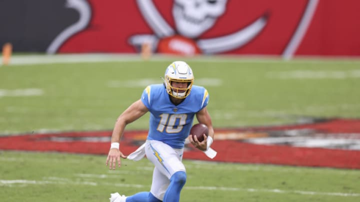 TAMPA, FLORIDA - OCTOBER 04: Justin Herbert #10 of the Los Angeles Chargers runs for yardage during the second quarter of a game against the Tampa Bay Buccaneers at Raymond James Stadium on October 04, 2020 in Tampa, Florida. (Photo by James Gilbert/Getty Images)