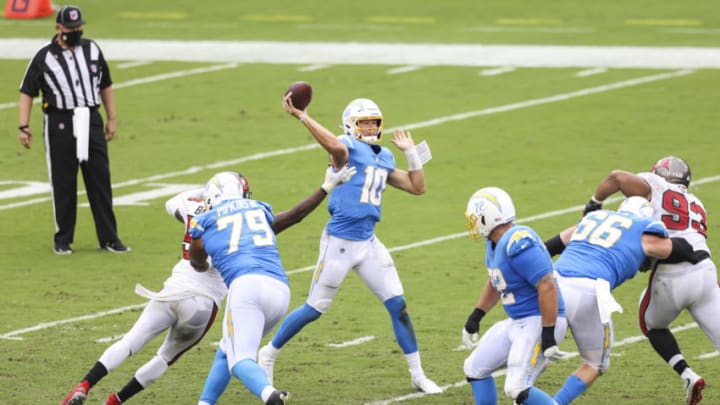 TAMPA, FLORIDA - OCTOBER 04: Justin Herbert #10 of the Los Angeles Chargers throws a pass during the fourth quarter of a game against the Tampa Bay Buccaneers at Raymond James Stadium on October 04, 2020 in Tampa, Florida. (Photo by James Gilbert/Getty Images)
