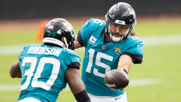 JACKSONVILLE, FLORIDA - OCTOBER 18: Gardner Minshew #15 of the Jacksonville Jaguars hands the ball off to James Robinson #30 during the second half of a game against the Detroit Lions at TIAA Bank Field on October 18, 2020 in Jacksonville, Florida. (Photo by James Gilbert/Getty Images)