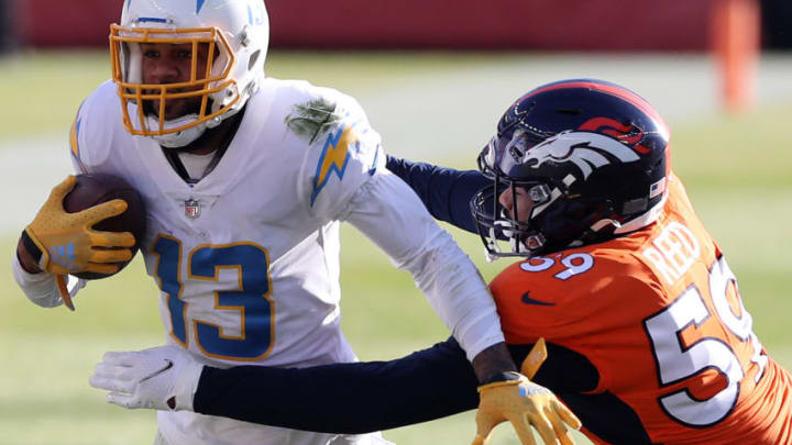 DENVER, COLORADO - NOVEMBER 01: Keenan Allen #13 of the Los Angeles Chargers carries the ball against Malik Reed #59 of the Denver Broncos in the first quarter of the game at Empower Field At Mile High on November 01, 2020 in Denver, Colorado. (Photo by Matthew Stockman/Getty Images)